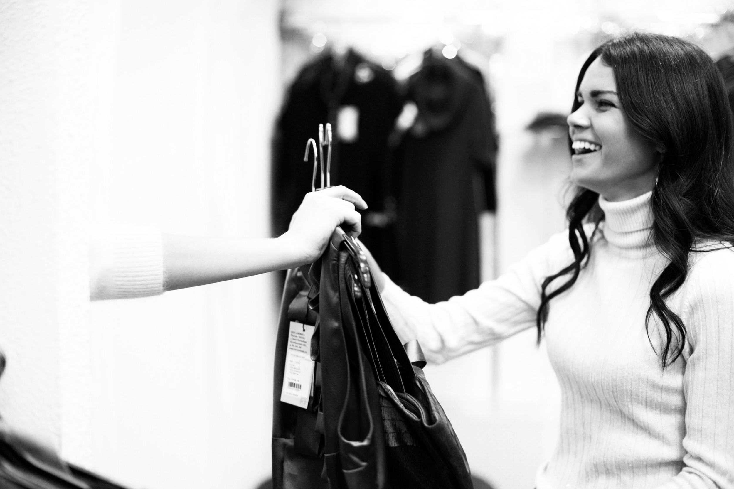 happy woman shopping price fitting