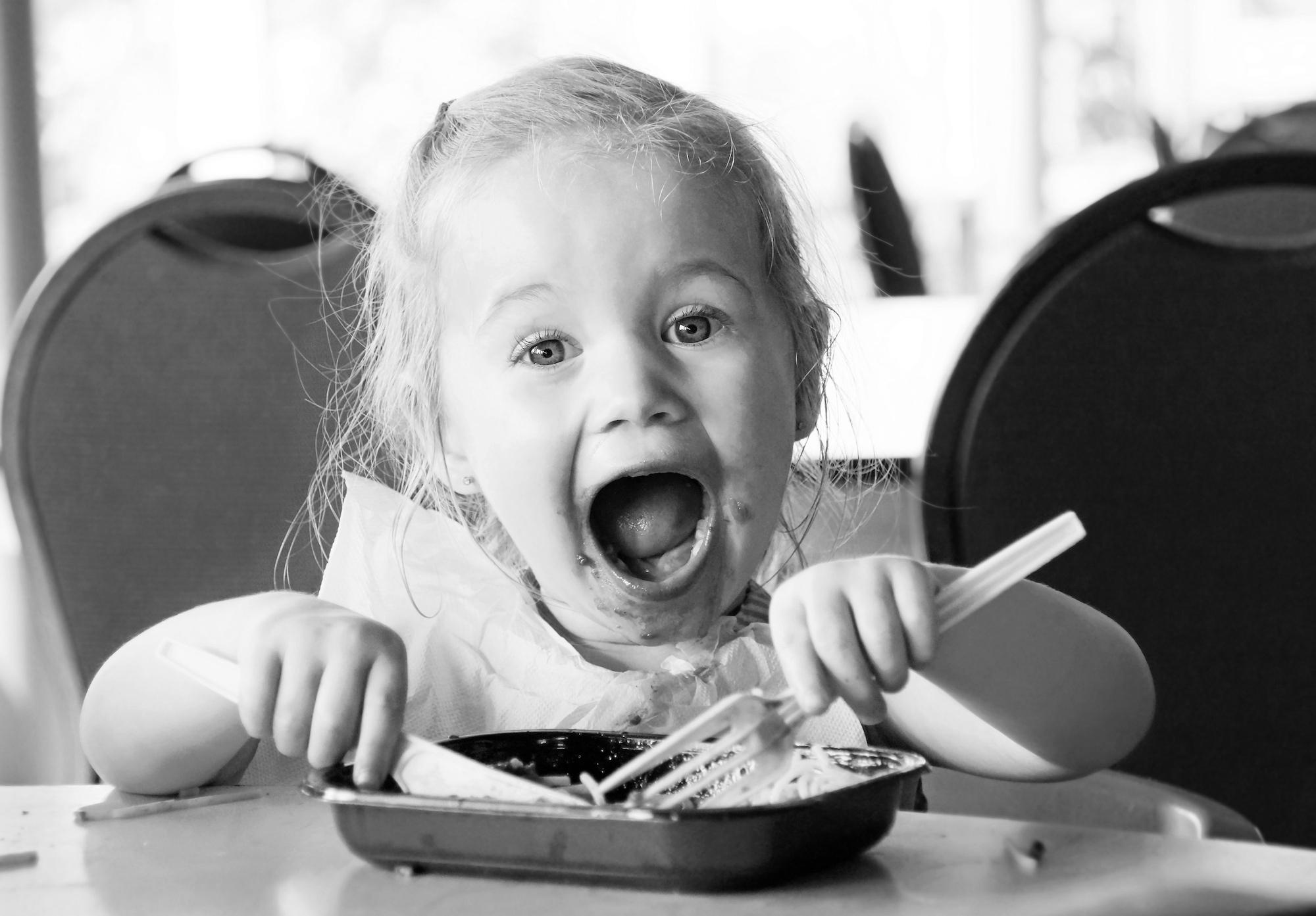 baby eating spaghetti play dough