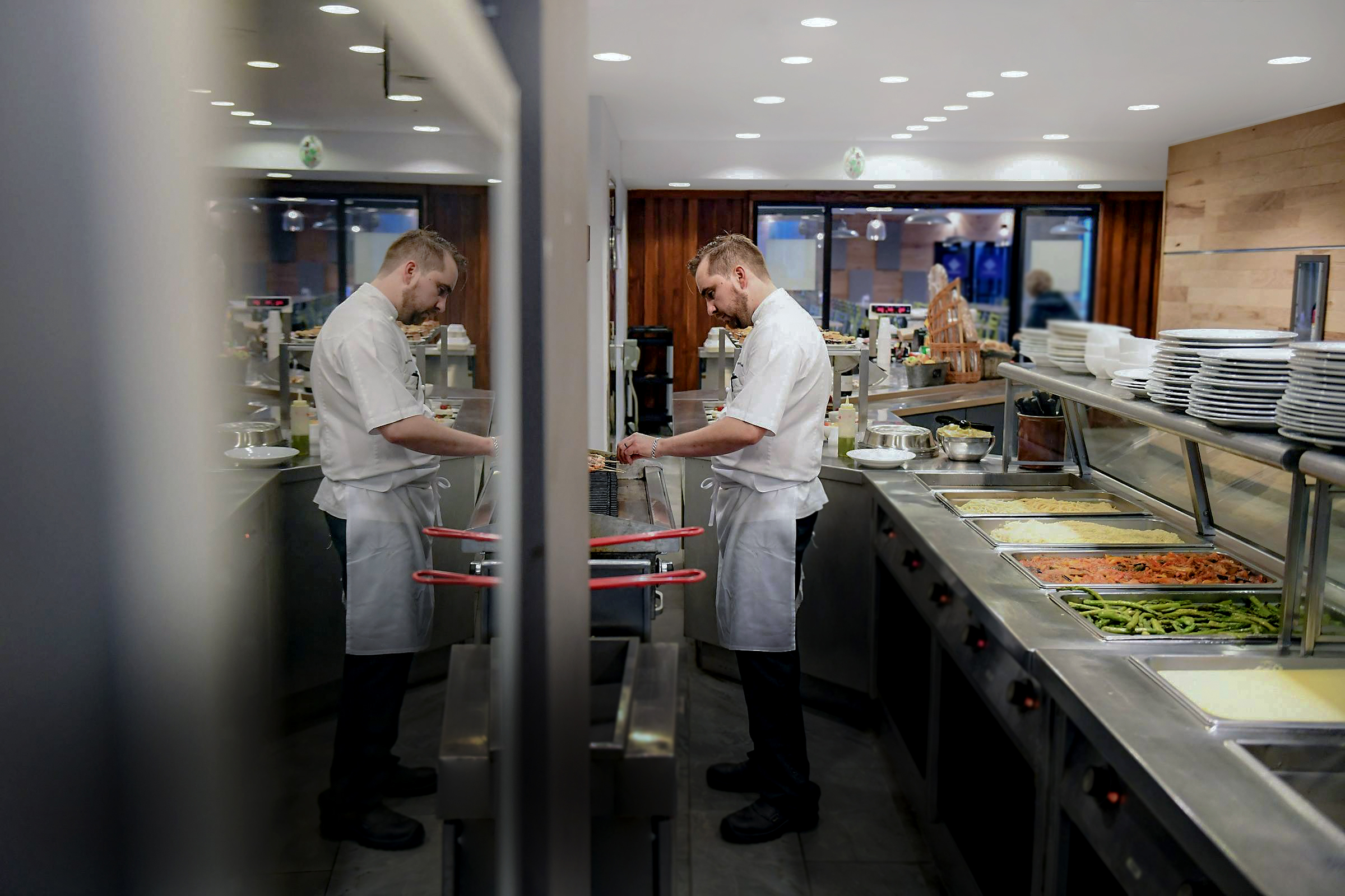 Chef Mark Courseille prepares lunch at Le Café Descartes in the French Embassy. (Matt McClain/The Washington Post)