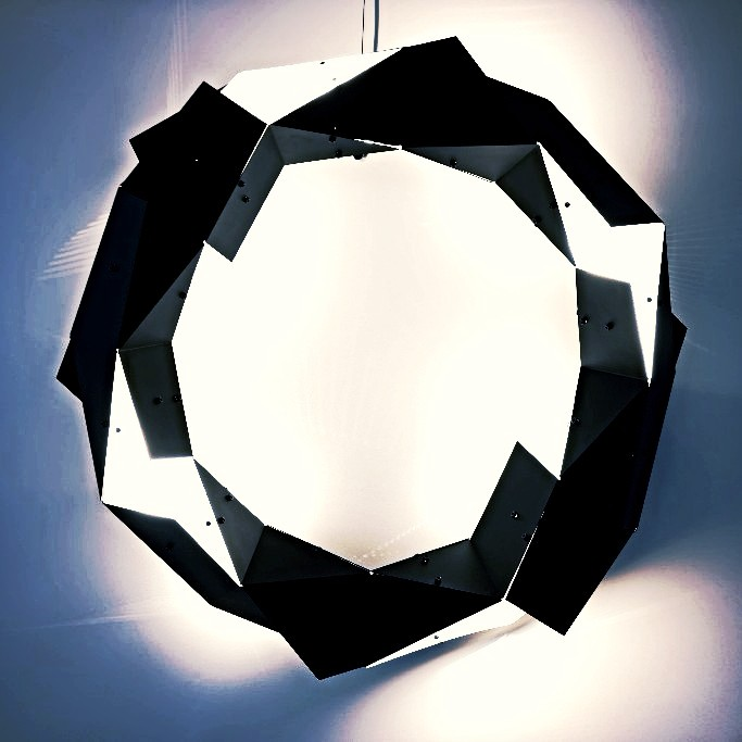 SUPERNOVA, A titanic explosion marked by a new light. It is an end, yet a beginning. Portrayed in a complex formation of luminous and obscure facets, housing lighting and designed to hover in space.