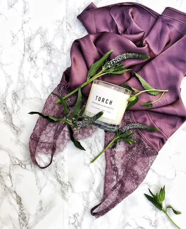 She Blooms - A delightful warm and comforting aroma. With top notes of Bergamot, Lemon Peels, Green Day lilies, and White floral notes.