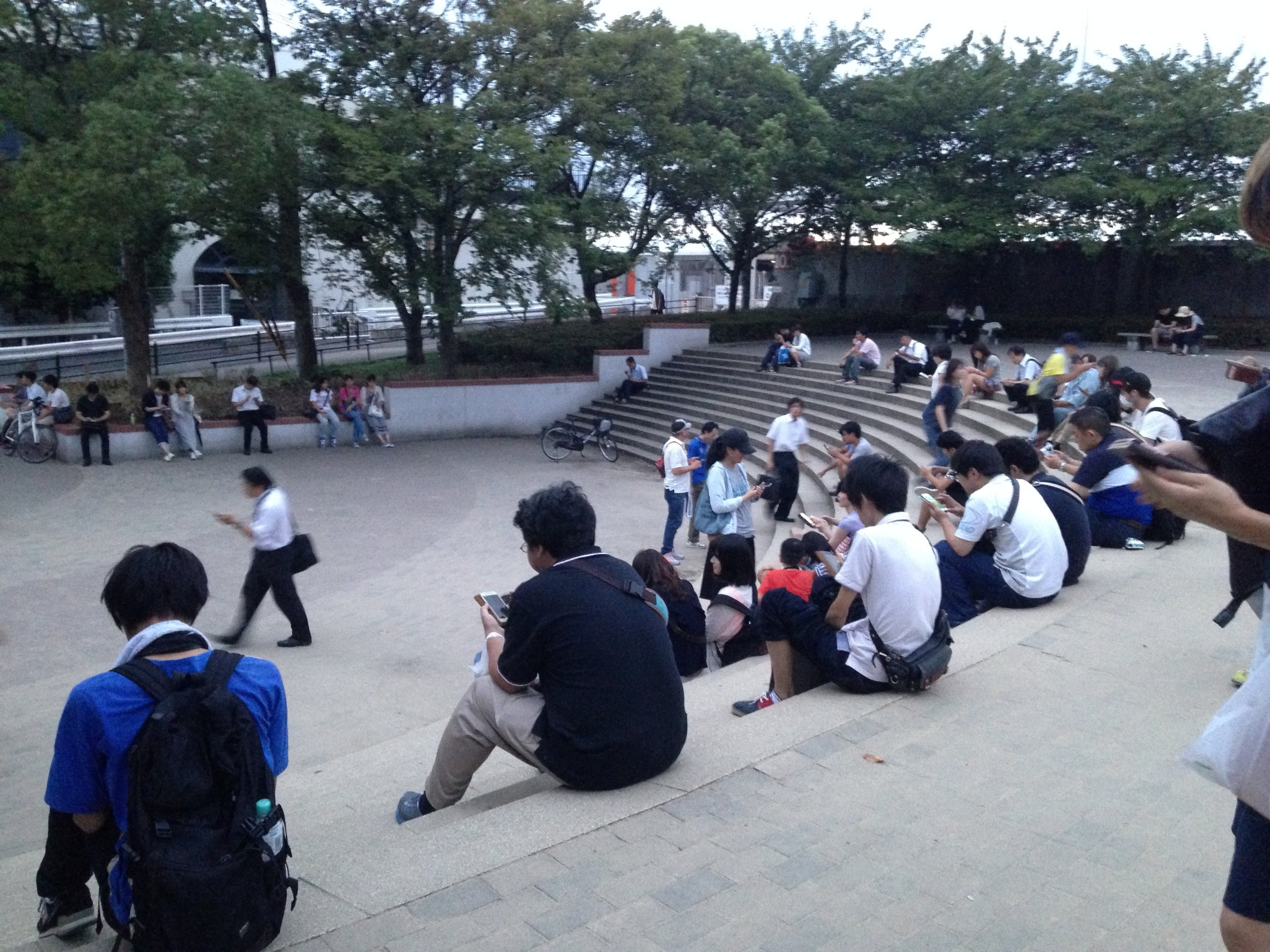 People playing Pokemon Go! in a park in Osaka