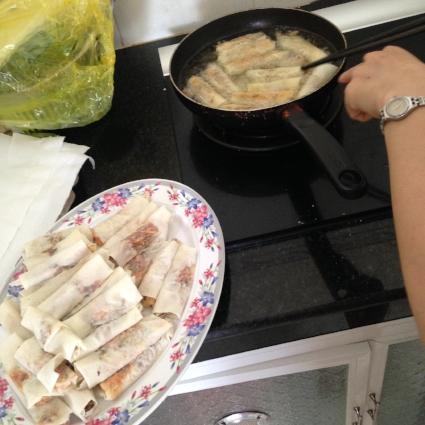 Frying spring rolls!