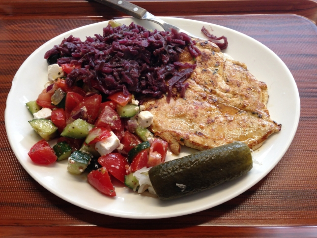 Chicken with beets, a stuffed pickle, and a cucumber, tomato, and mozzarella salad