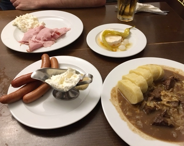 Some yummy Czech food-- Prague ham with whipped horseradish, camembert cheese, sausage, and goulash! We can eat all of this, except the potato dumplings! Not bad!