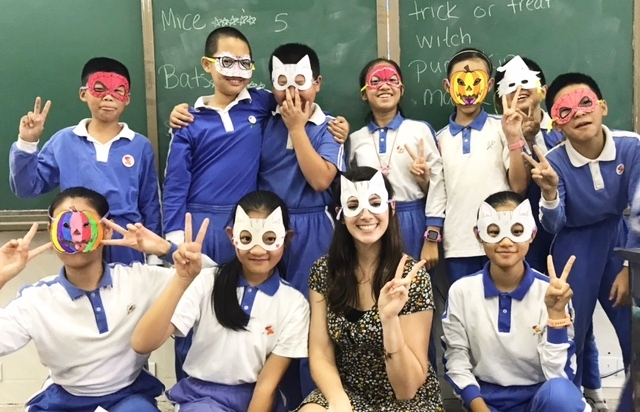Just me with one of my classes after making Halloween masks!