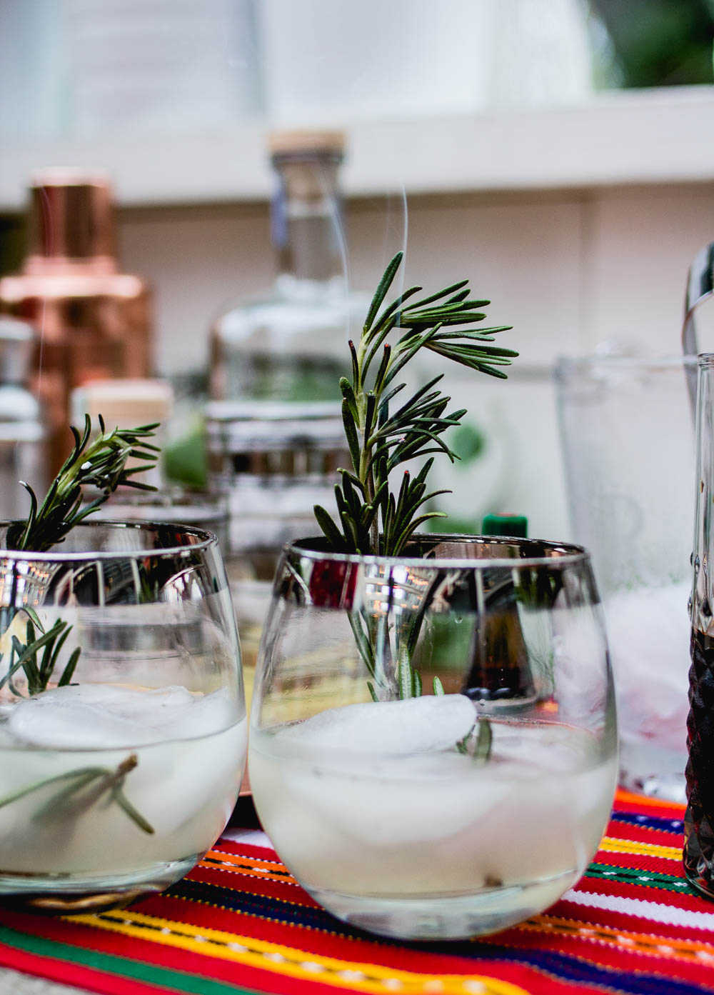 Photo by    Very Sarie   . (Flaming Rosemary Gimlet cocktail by    Shaker & Spoon   .)