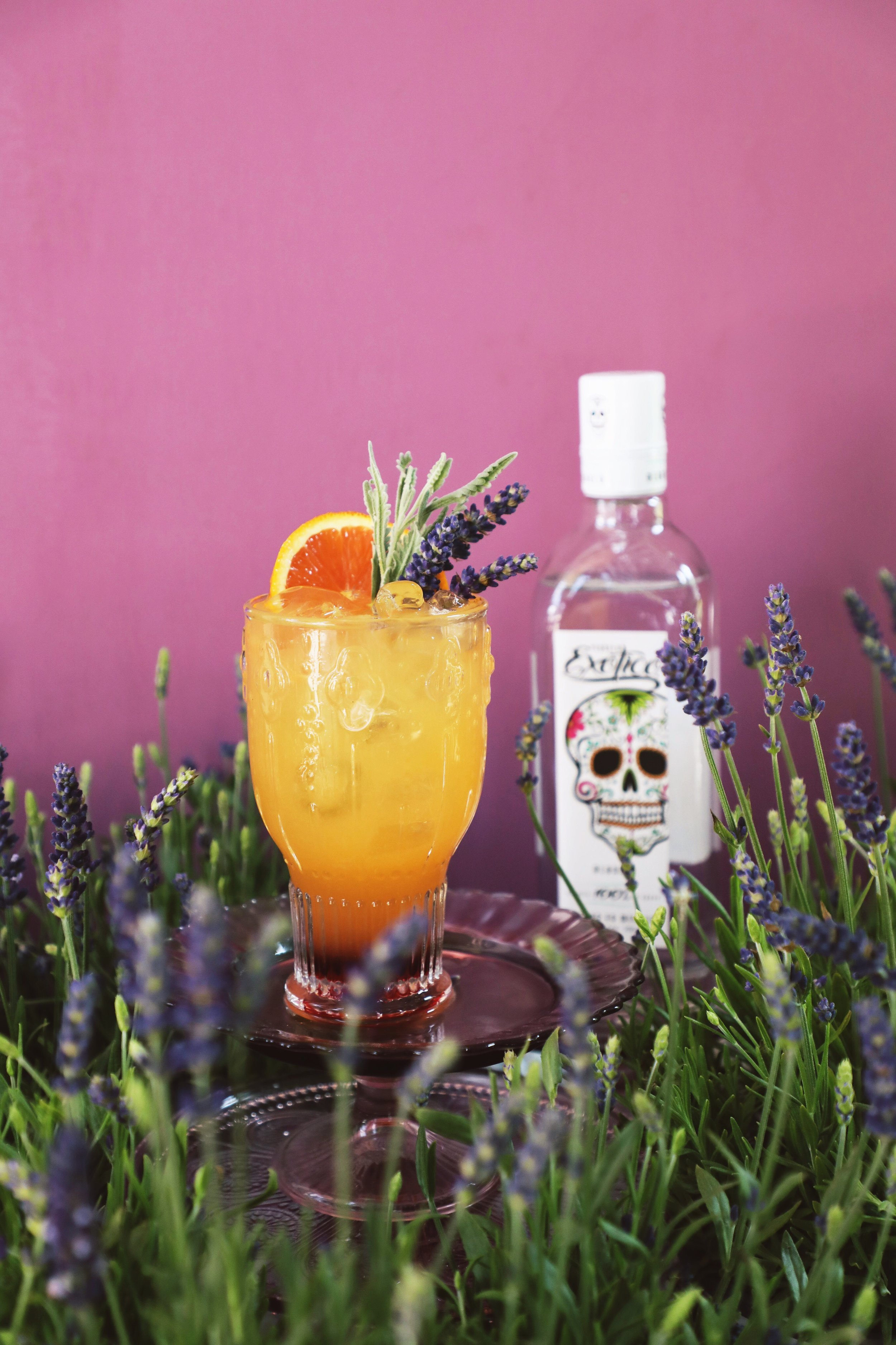 Lavender Tequila Sunrise made with Exotico Blanco Tequila, fresh orange juice, and a lavender-infused grenadine | drinkingwithchickens.com