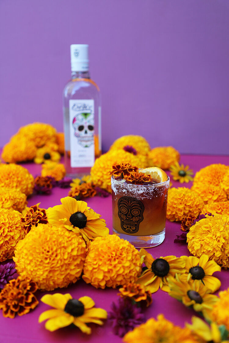 Marigold Margarita Sour made with Exotico Tequila Blanco, marigold syrup, orange and lime juices, and a float of red wine | drinkingwithchickens.com #sponsored
