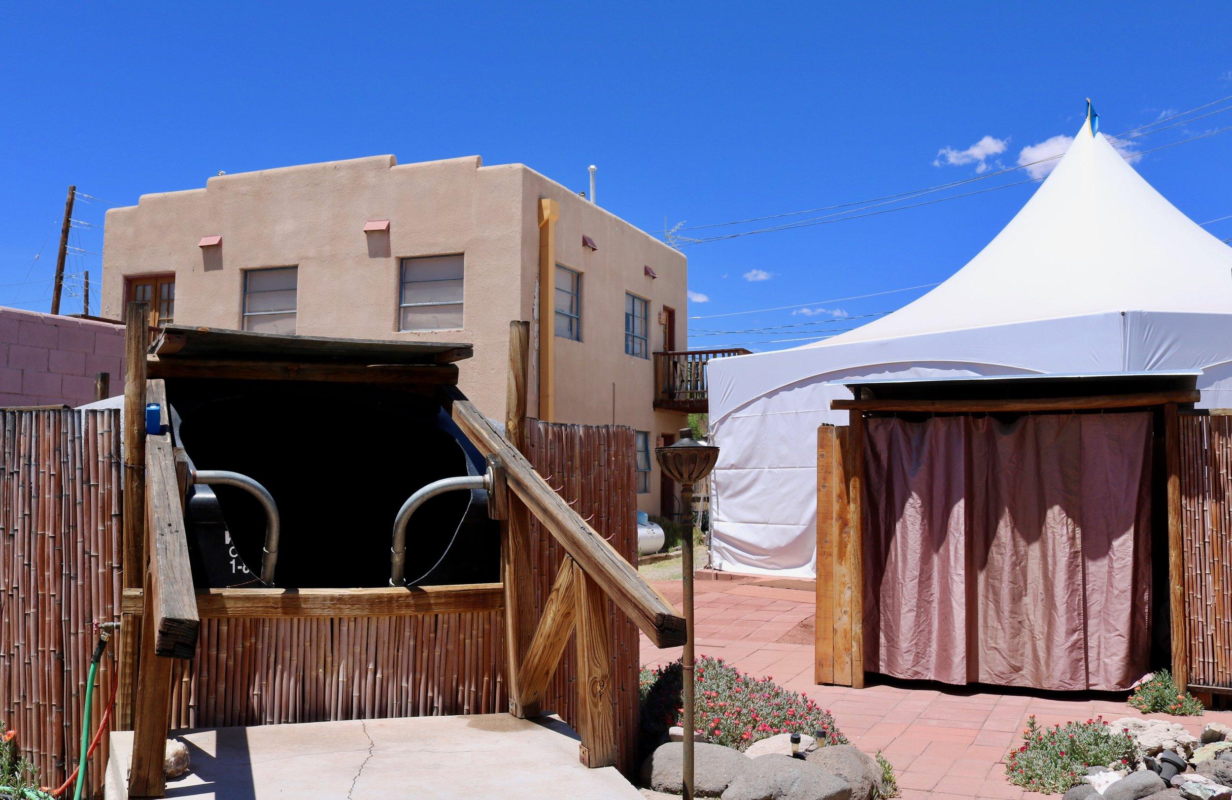 II grounds - turtle tank, tent, building.jpg