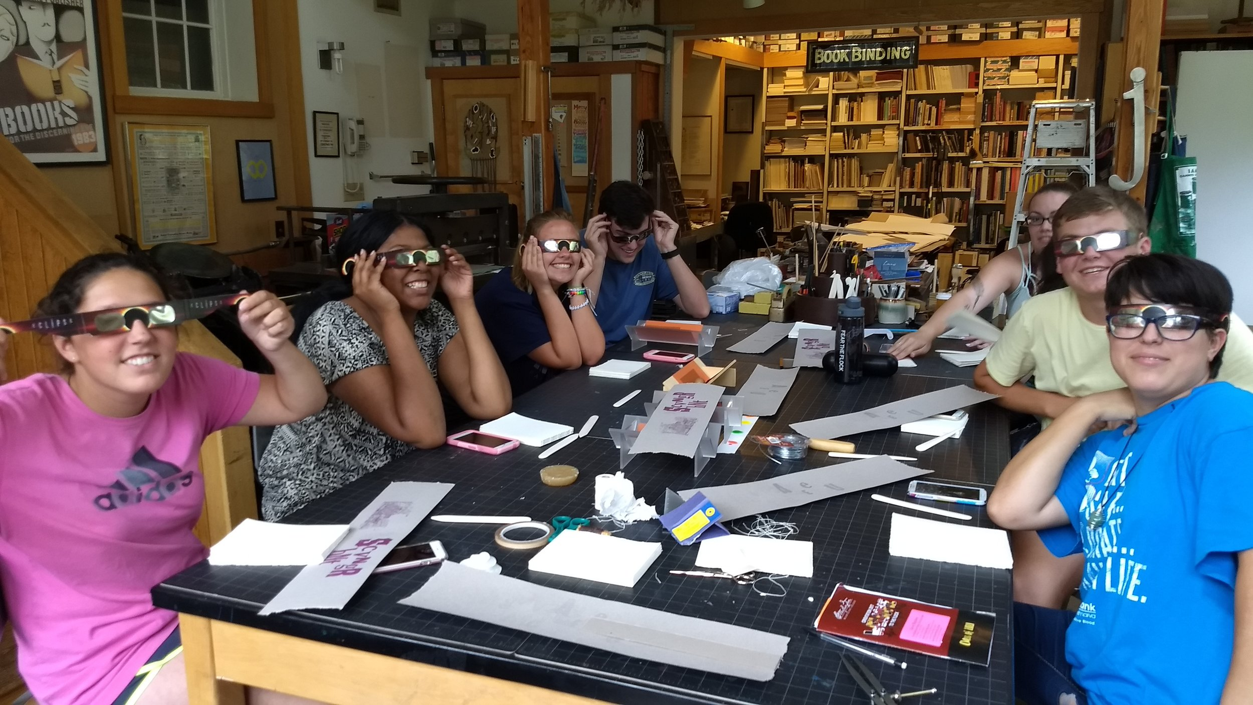 Incoming Washington College freshmen work right through the solar eclipse of 2017 to bind their books,