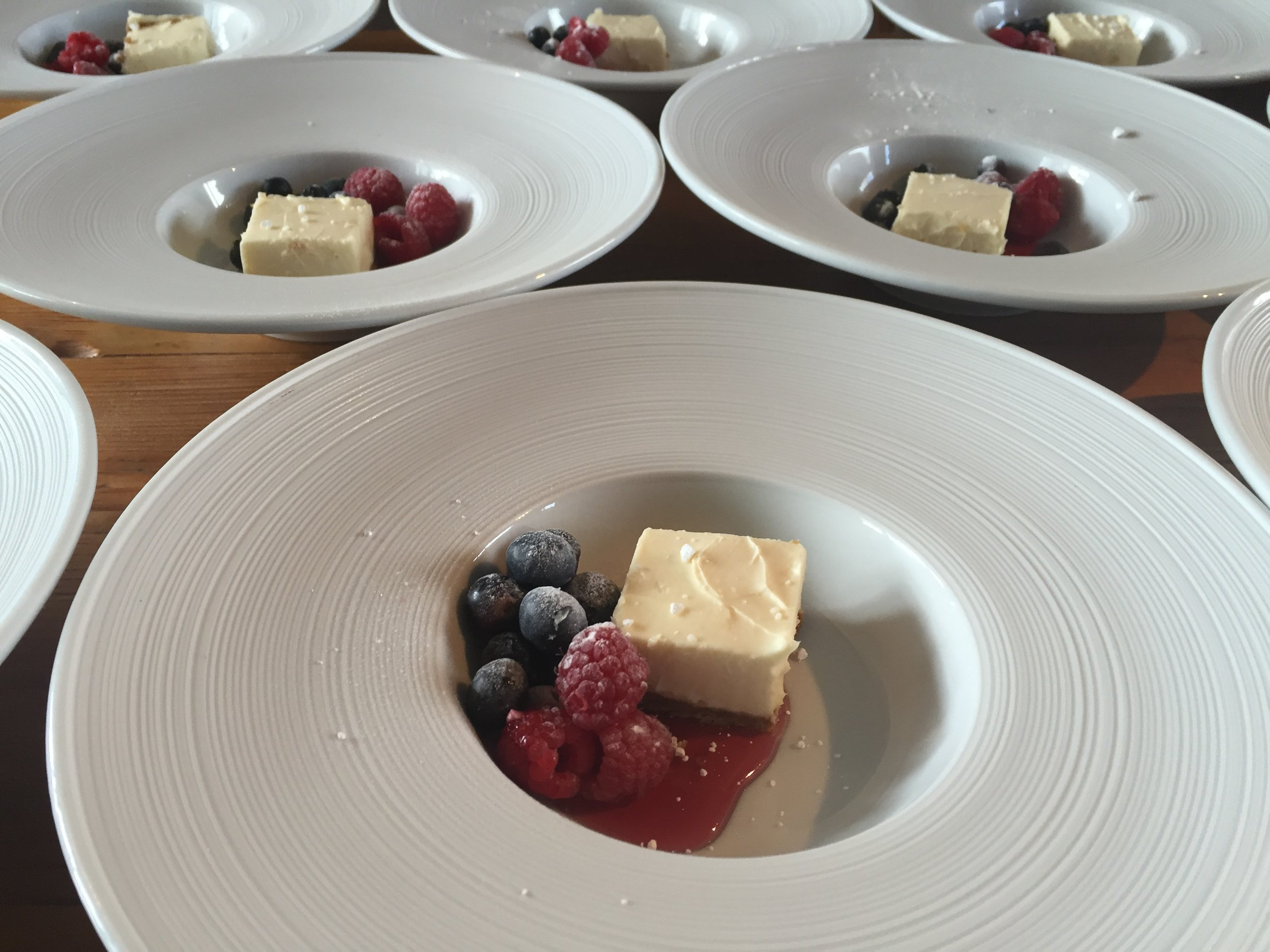 Lemon and Ginger cheesecake with berries and coulis