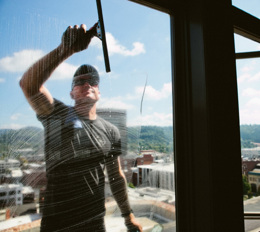 window cleaner through soapy window with bb&t building in background.jpg
