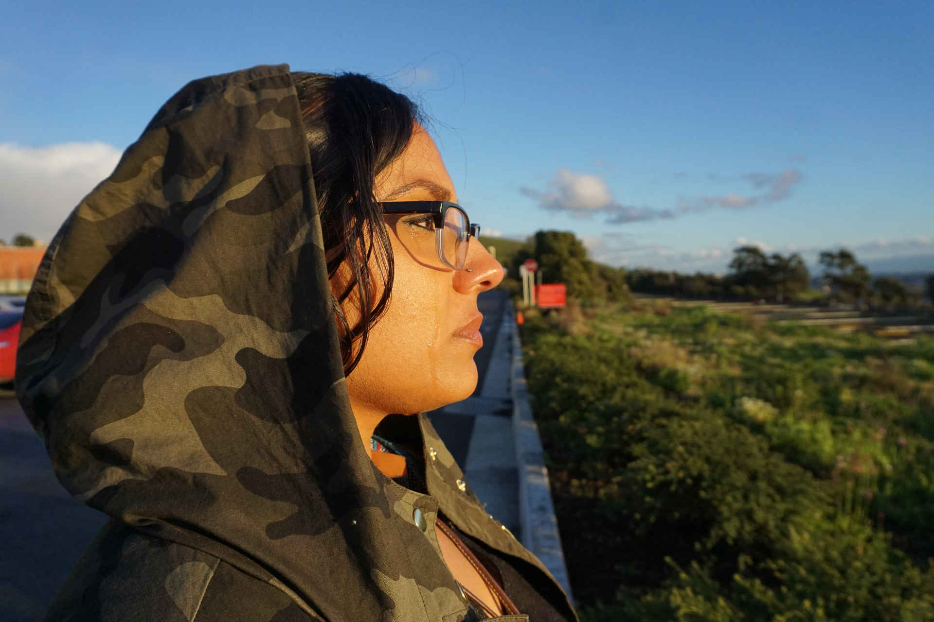 A sister weeps at a sentimental location as she remembers her brother.