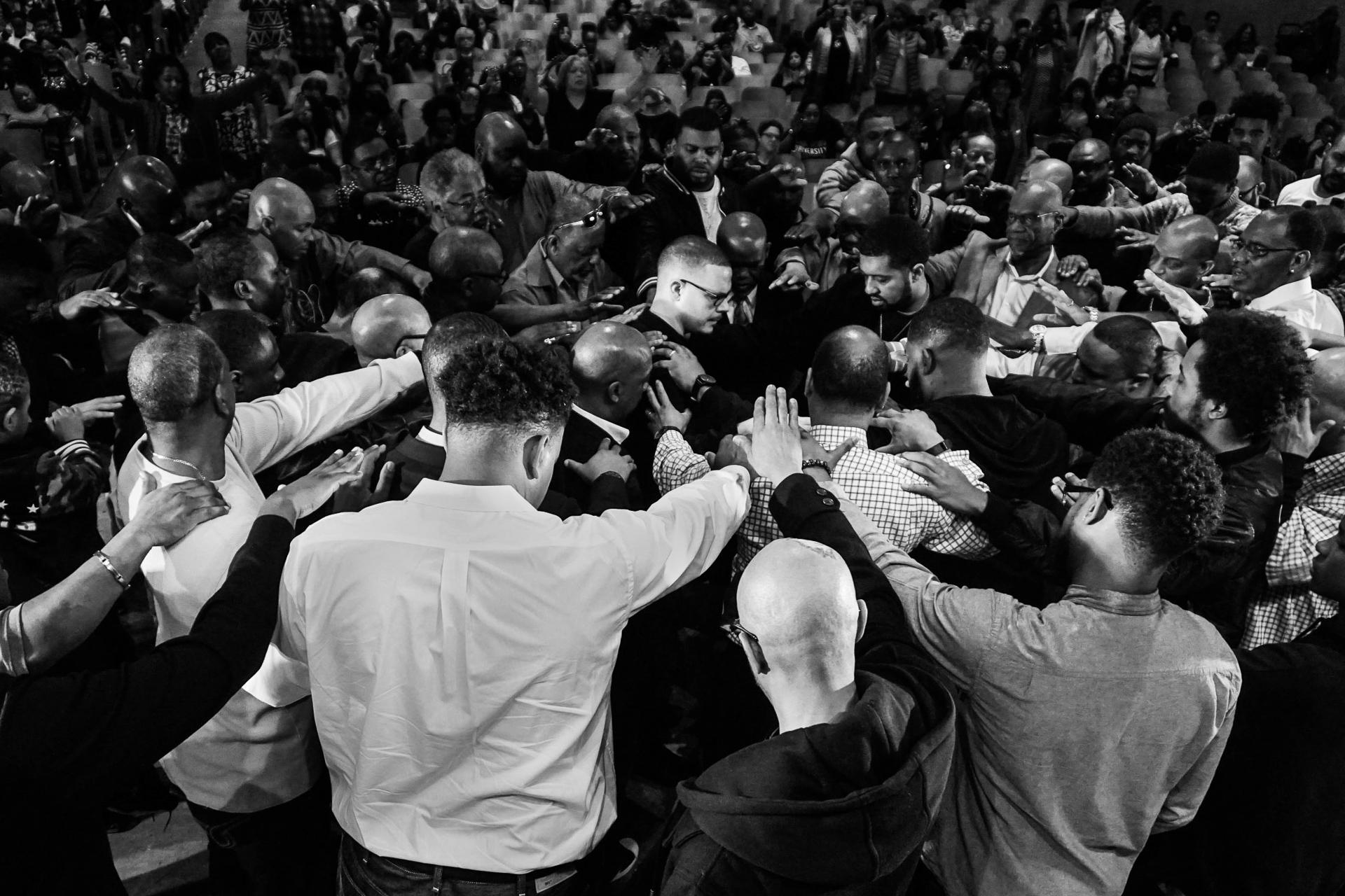 Shaun King receives prayer at church service.