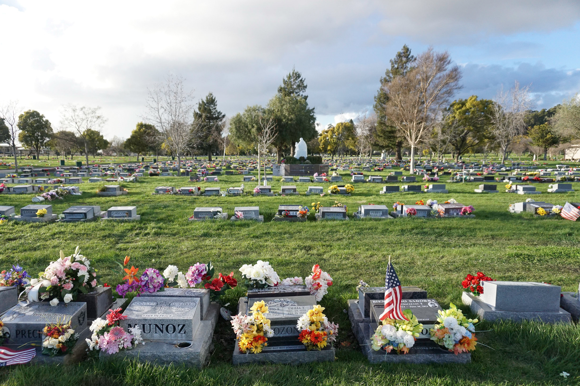 A cemetary breathes life through color, honoring loved ones now passed.