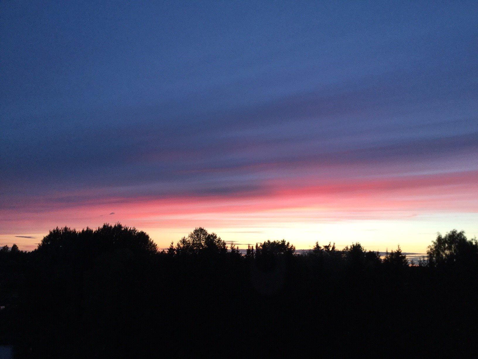 Finland! - Our volunteer Jenni, looking out her hotel balcony at the midnight sun!We miss you Jenni, but wow! Gorgeous!