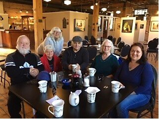 Walking Group - A few of our volunteers with some of our community friends enjoying a cup of coffee after a lovely walk on a beautiful sunny day.