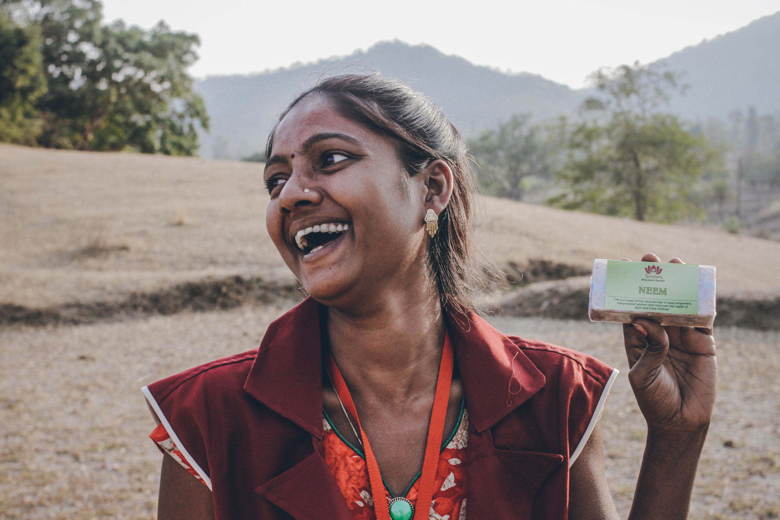 Yogita proudly showing us a Sundara bar of soap she has made herself. Photo credit: Karan Khosla.