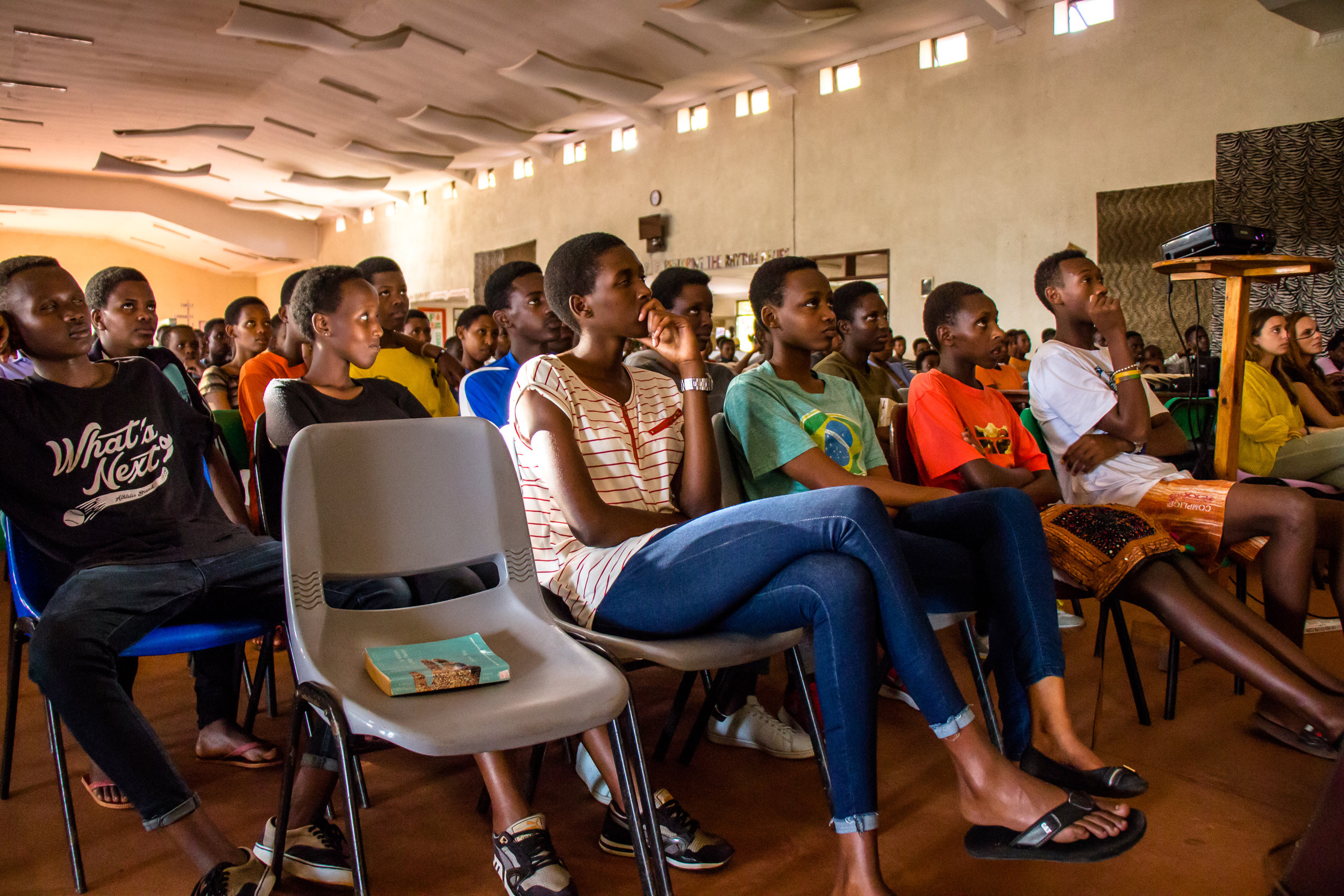 Students listening at a presentation on social businesses by the Sundara team