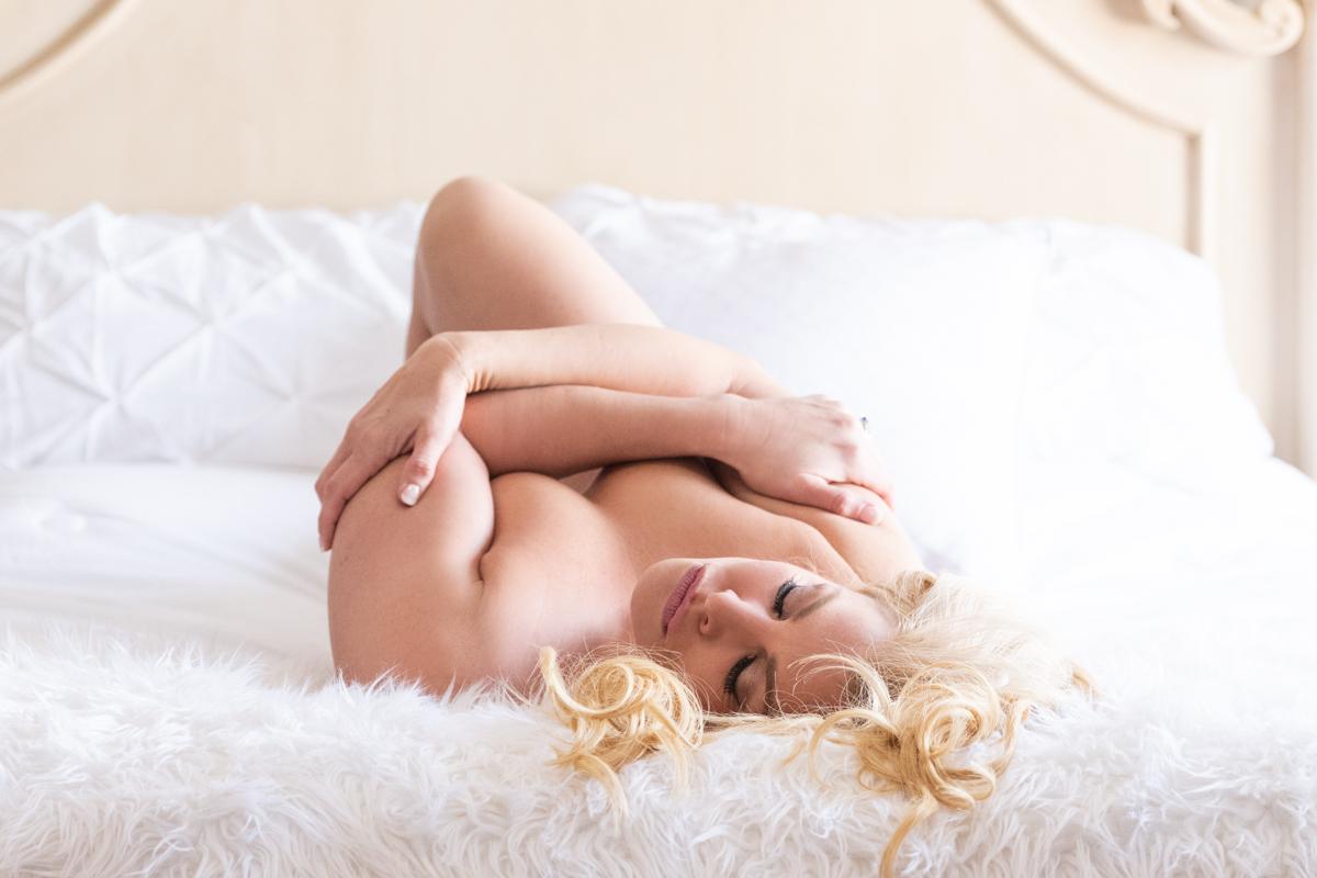 Studio Phoenix Boudoir Photography Omaha woman on back on bed.jpg