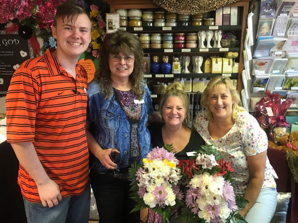Forrest Freeman (PR and Delivery driver), Debbie Wesley, Mindy Skinner (patron who took the class) and Daryl Sandlan (floral design and deliveries).