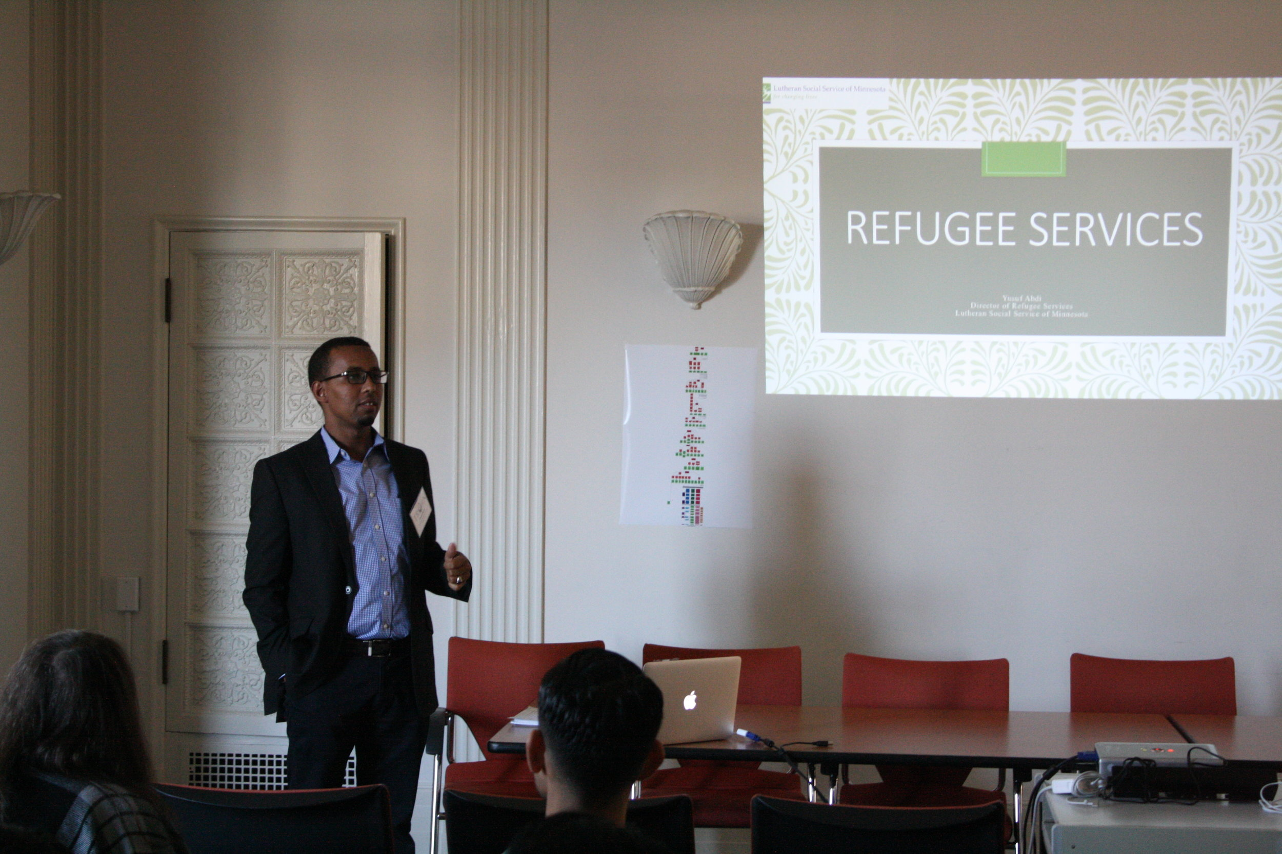 """Yusuf Abdi, Program Director of Refugee Services of Lutheran Social Services of Minnesota gives an inspiring speech on his journey to the US as a refugee from Somalia. He also shares a community education program he helped develop called """"My Neighbor is Muslim.""""   Refugee Resettlement, Community Empathy, and Integration"""