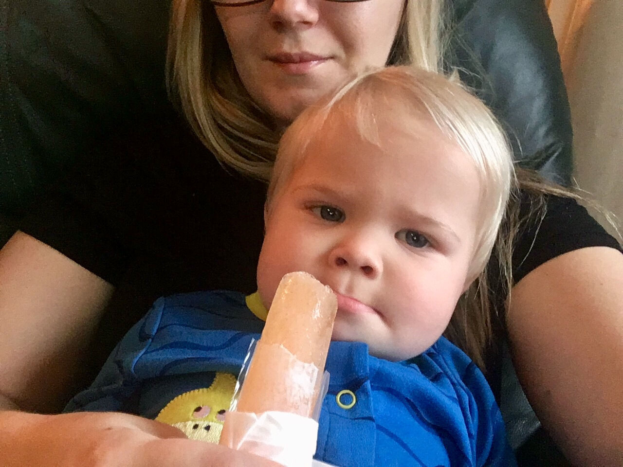 Baby boy stubbornly refusing his Pedialyte popsicle.
