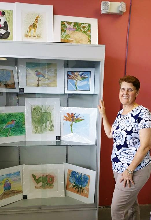 Carlene with her prints at And33's. Source: Carlene Harris