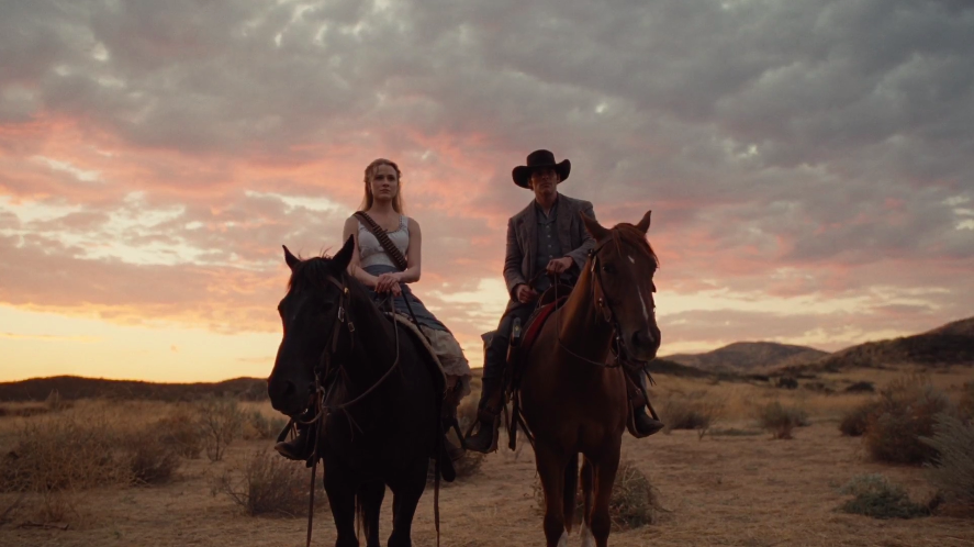 Dolores and Teddy on Horseback.png