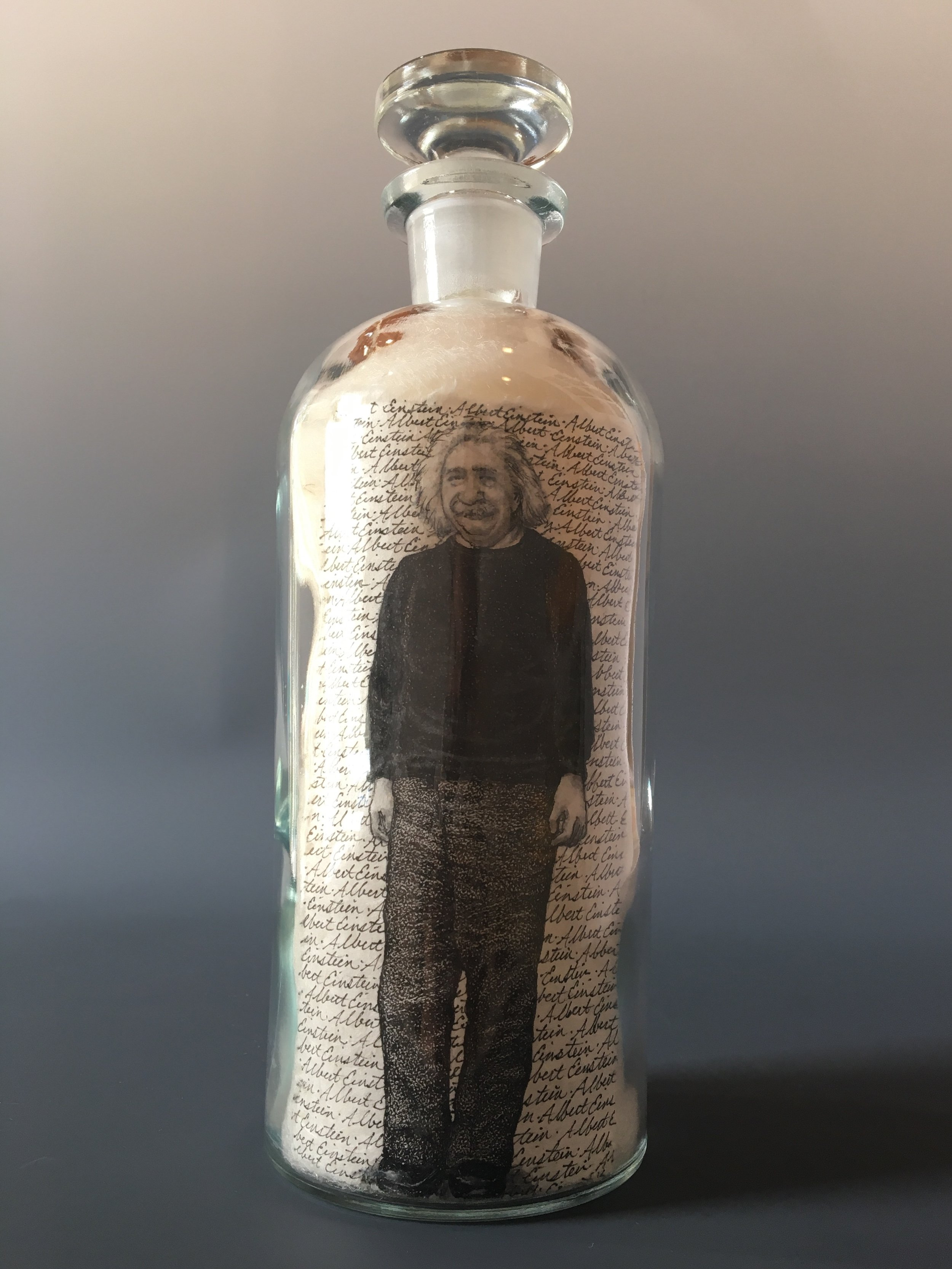 "This Was Albert Einstein. ""The difference between genius and stupidity is genius has its limits.""  bottle drawing; ink, graphite, white charcoal on handmade paper, glass bottle, wool"