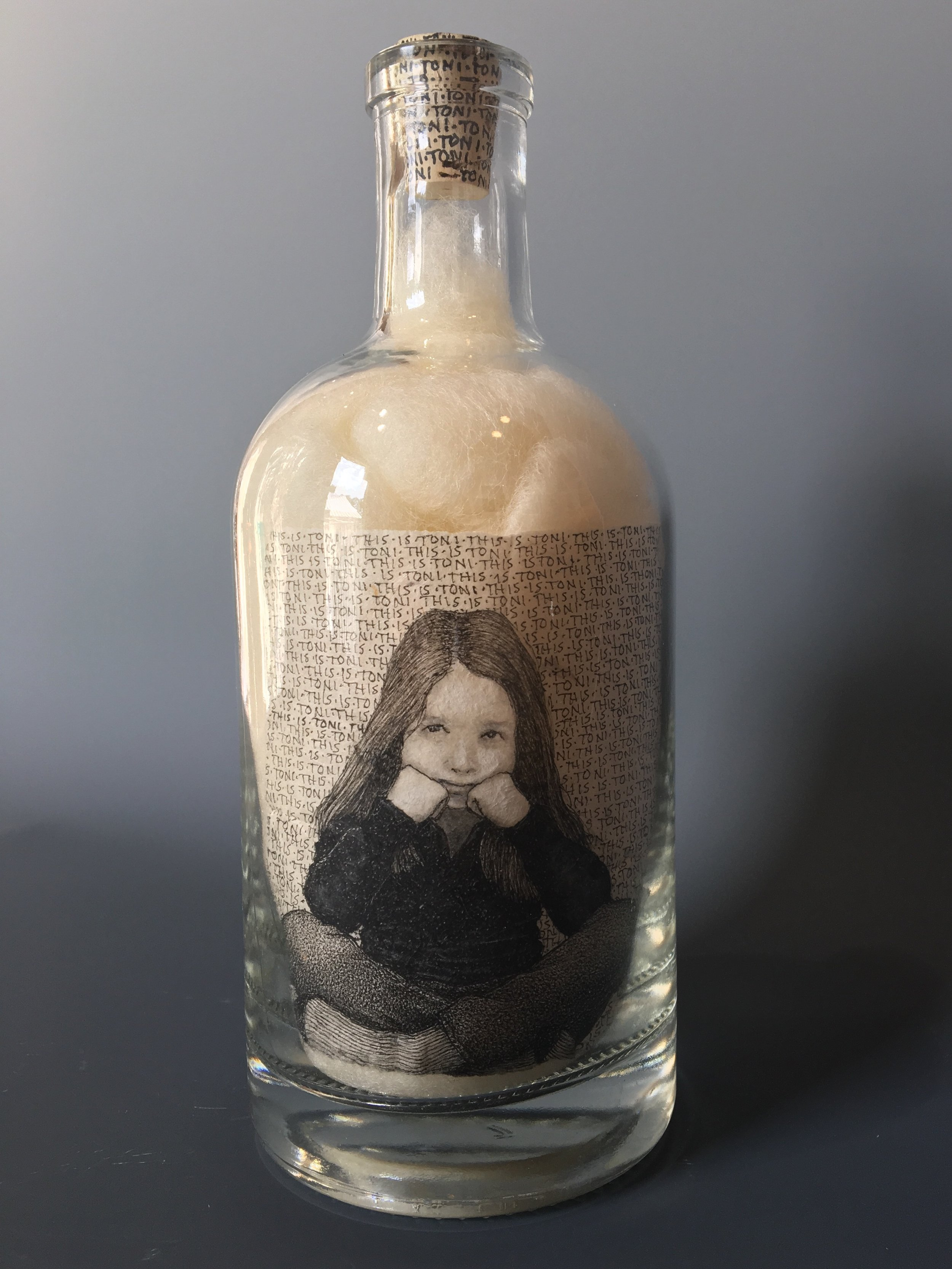 This is Toni  —  Nobody is Doing What She Wants!  bottle drawing; ink, graphite, white charcoal on handmade paper, glass bottle, wool