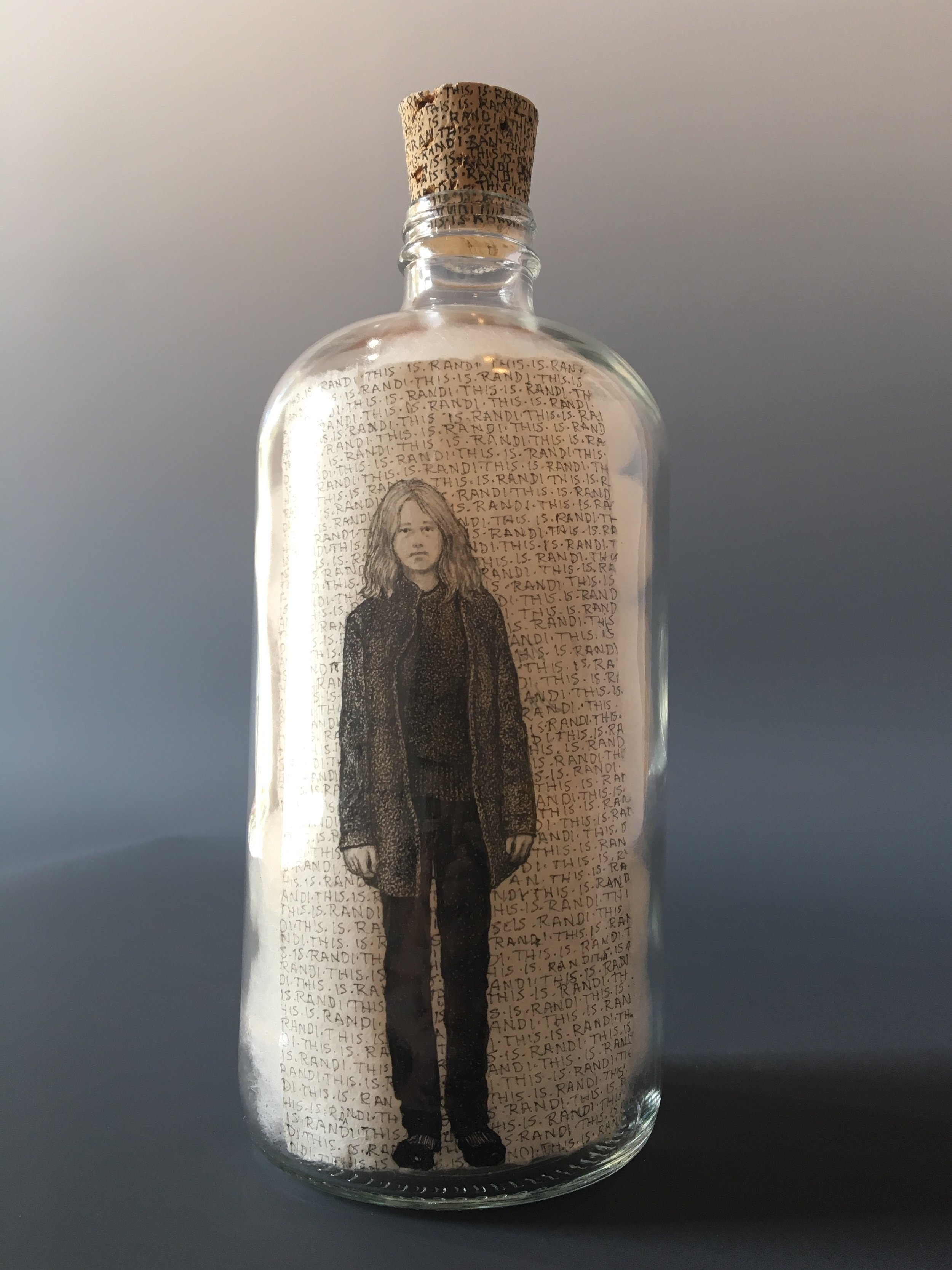 This is Randi  — She has no idea what's going on.   bottle drawing; ink, graphite, white charcoal on handmade paper, glass bottle, wool