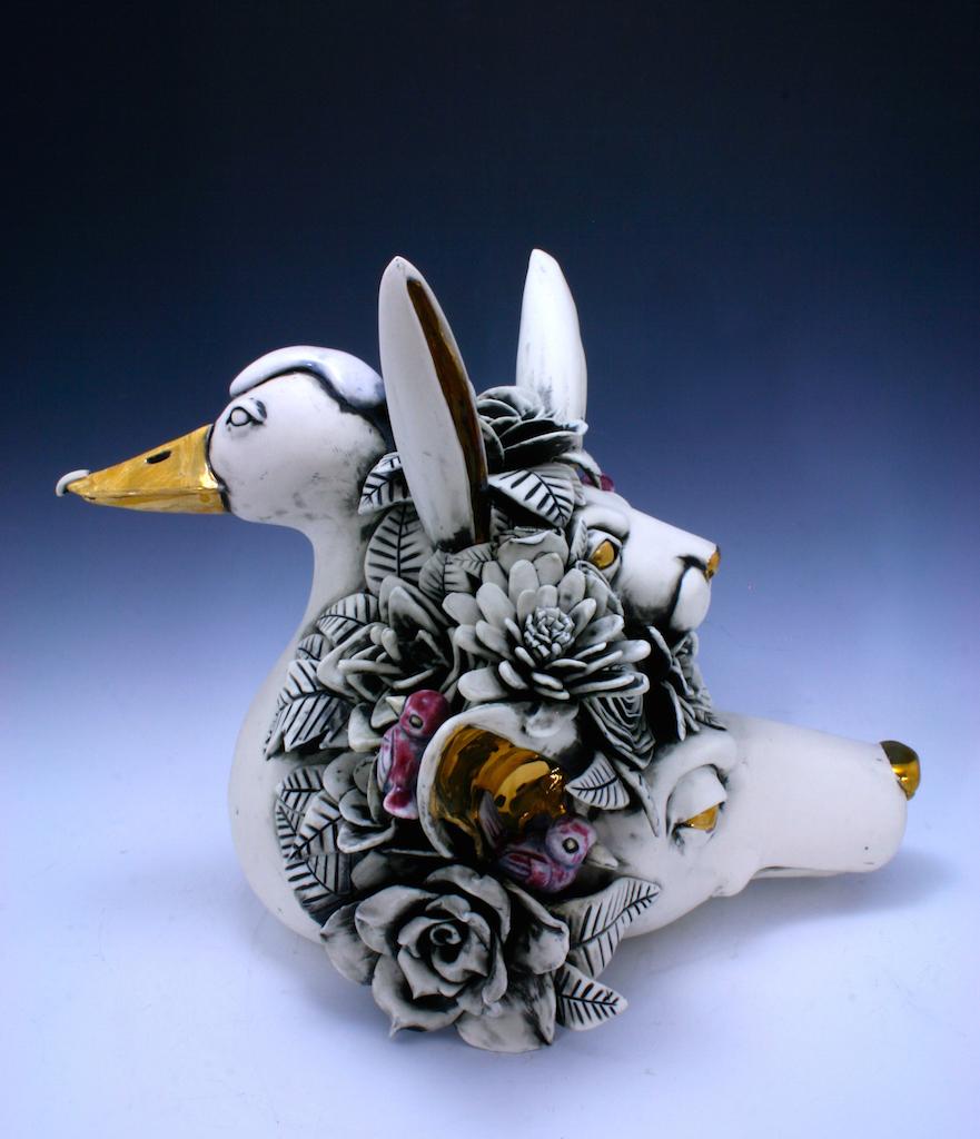 Duck Wins  porcelain sculpture,H10.5'' x L13'' x W11''