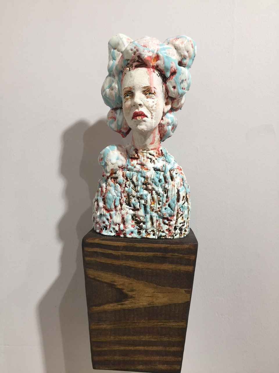 """Character Blocks: Louise,"" 7-10"" porcelain with many layers of slip and glazes mounted on a block of wood"