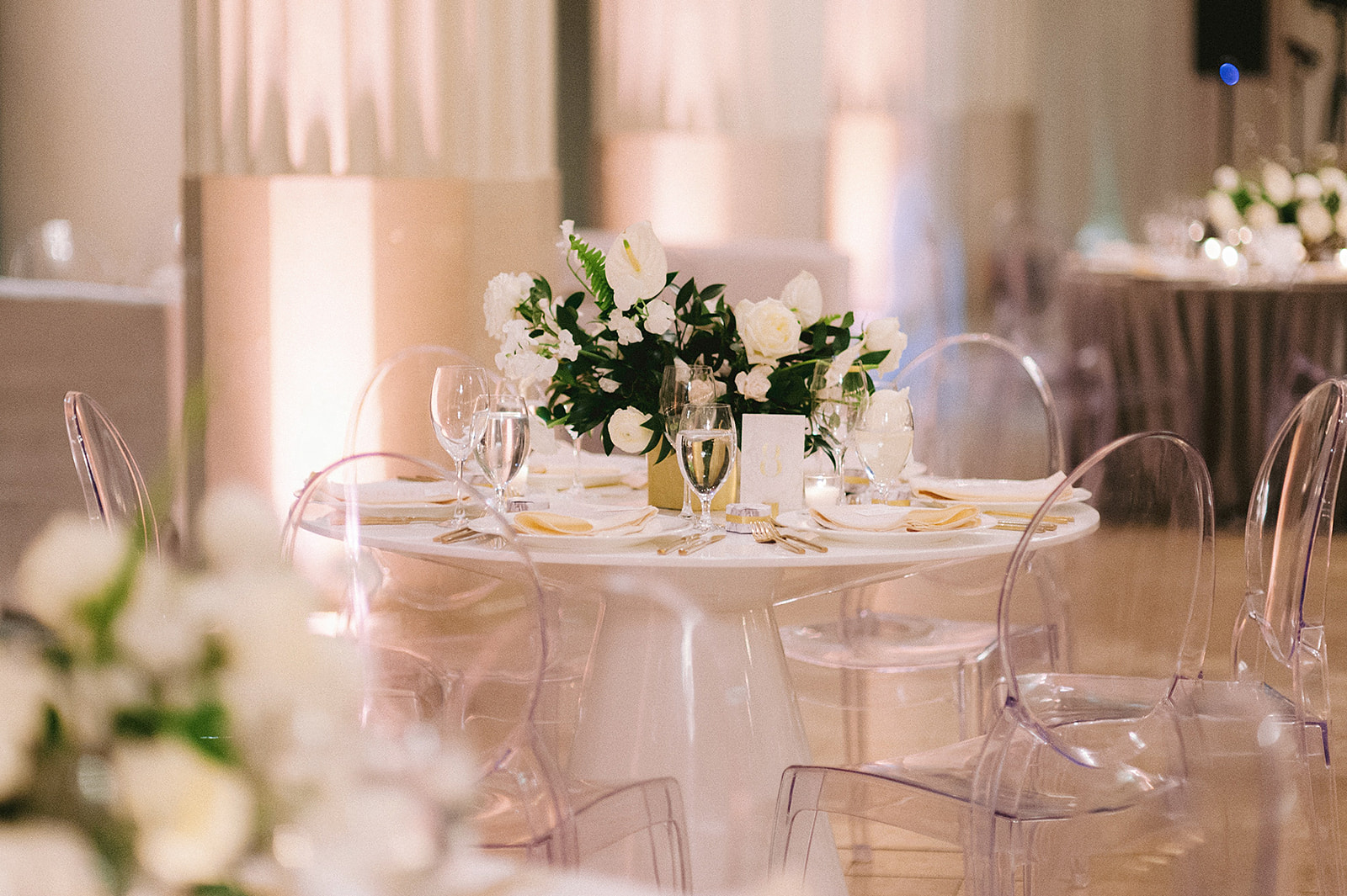 For Michelle and Soo's Modern Luxe wedding in the heart of downtown Houston, Spell Events…romantic candlelit tablescape with marble accents and large floral installation