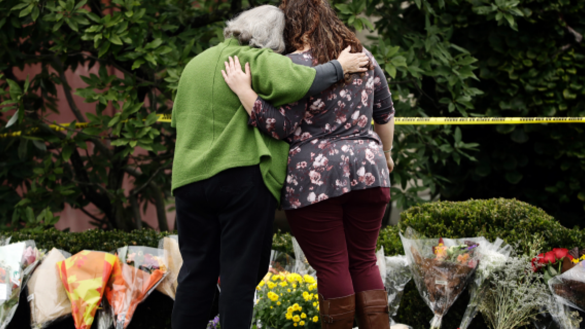 Two women visit the memorial for the October 28th shooting at the Tree of Life Synagogue.