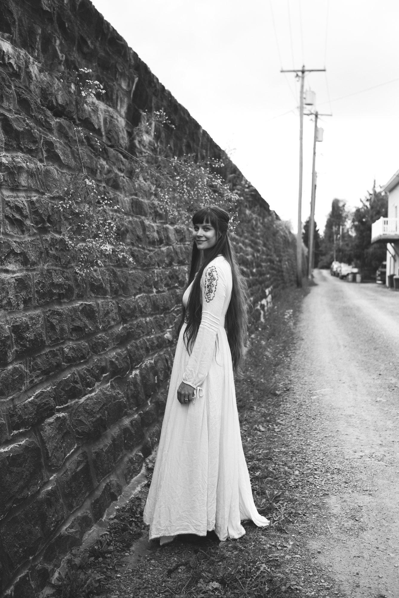Mountains, Outdoors, Rustic, West Virginia, Maryland Wedding Photographer, DIY, Casual, Bride posing and smiling before ceremony, Romantic and Boho bride, black and white photo