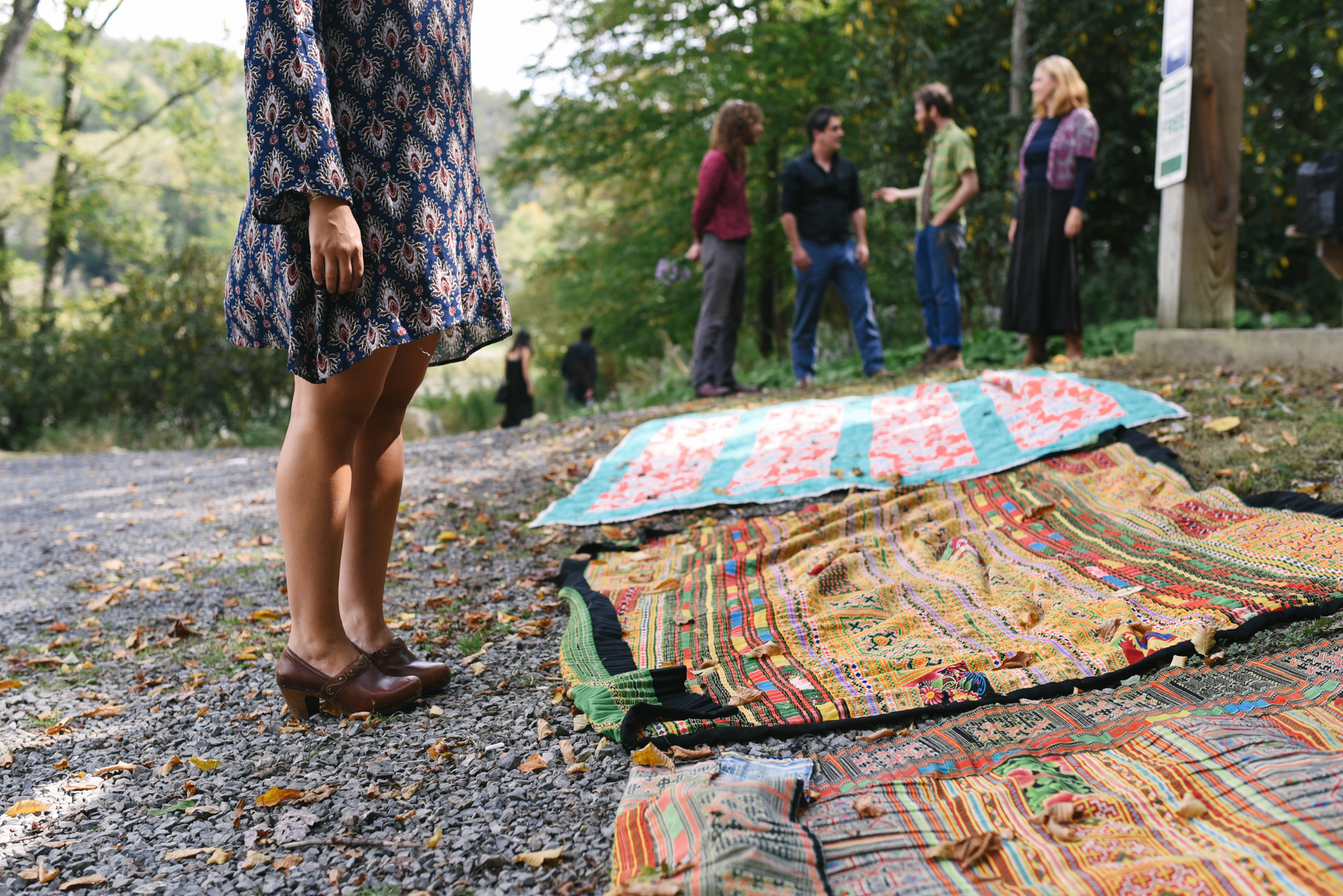 Mountain Wedding, Outdoors, Rustic, West Virginia, Maryland Wedding Photographer, DIY, Casual, Laying out colorful blankets before ceremony