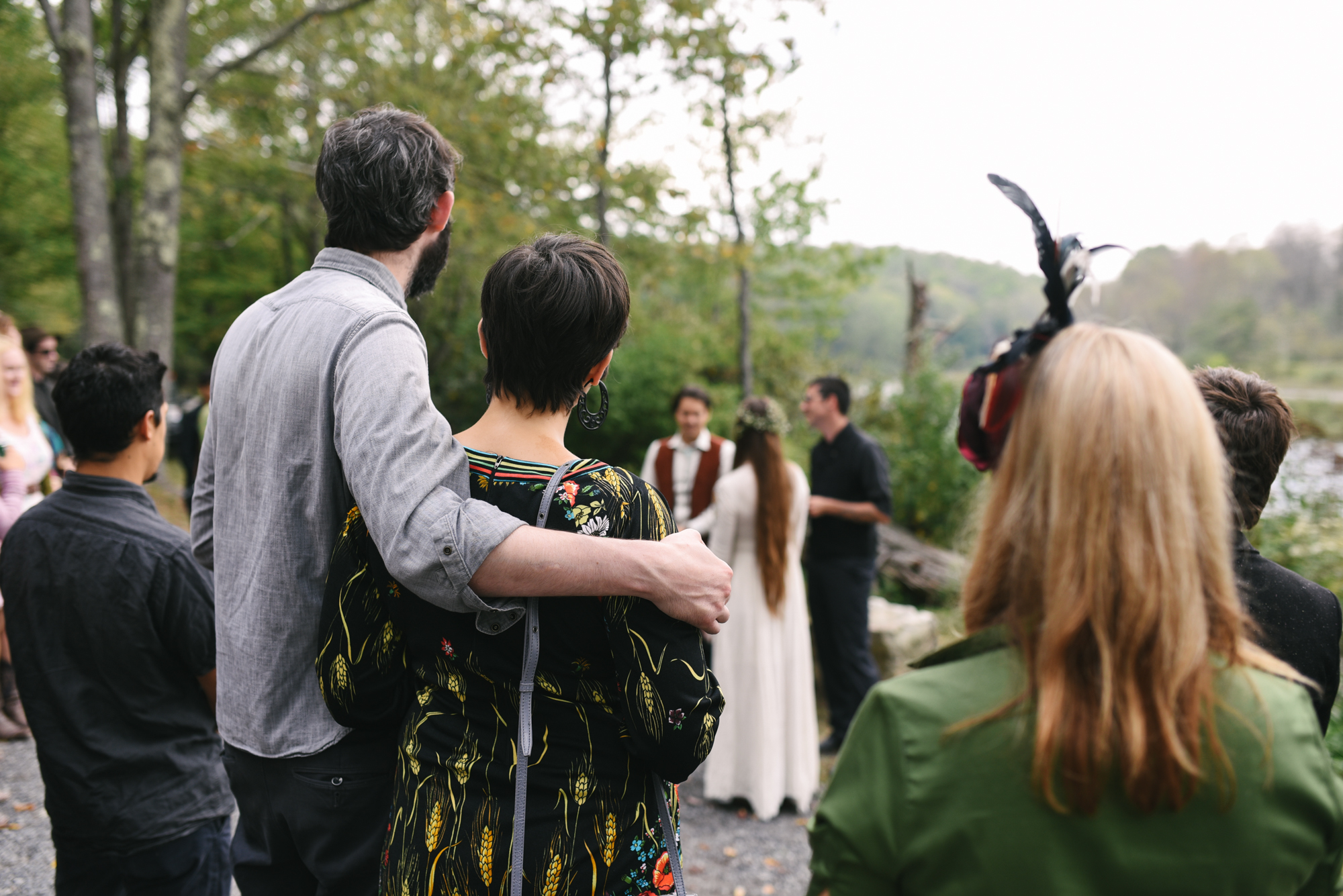 Mountain Wedding, Outdoors, Rustic, West Virginia, Maryland Wedding Photographer, DIY, Casual, Guests hugging and watching ceremony