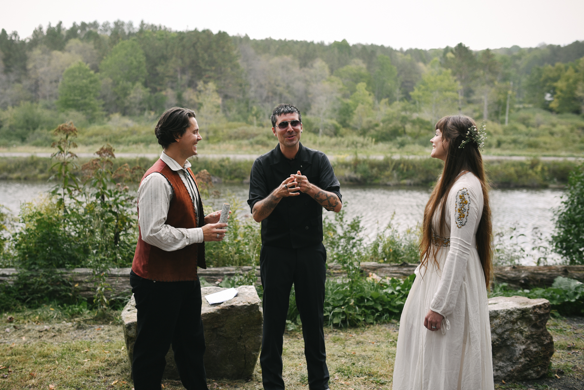 Mountain Wedding, Outdoors, Rustic, West Virginia, Maryland Wedding Photographer, DIY, Casual, bride and groom standing in front of officiant, Embroidered wedding dress
