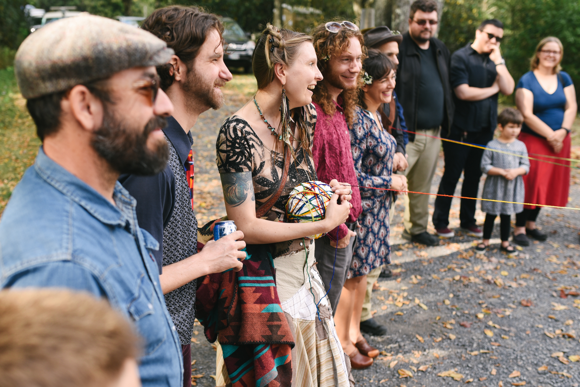 Mountain Wedding, Outdoors, Rustic, West Virginia, Maryland Wedding Photographer, DIY, Casual, Guests in yarn weaving ceremony