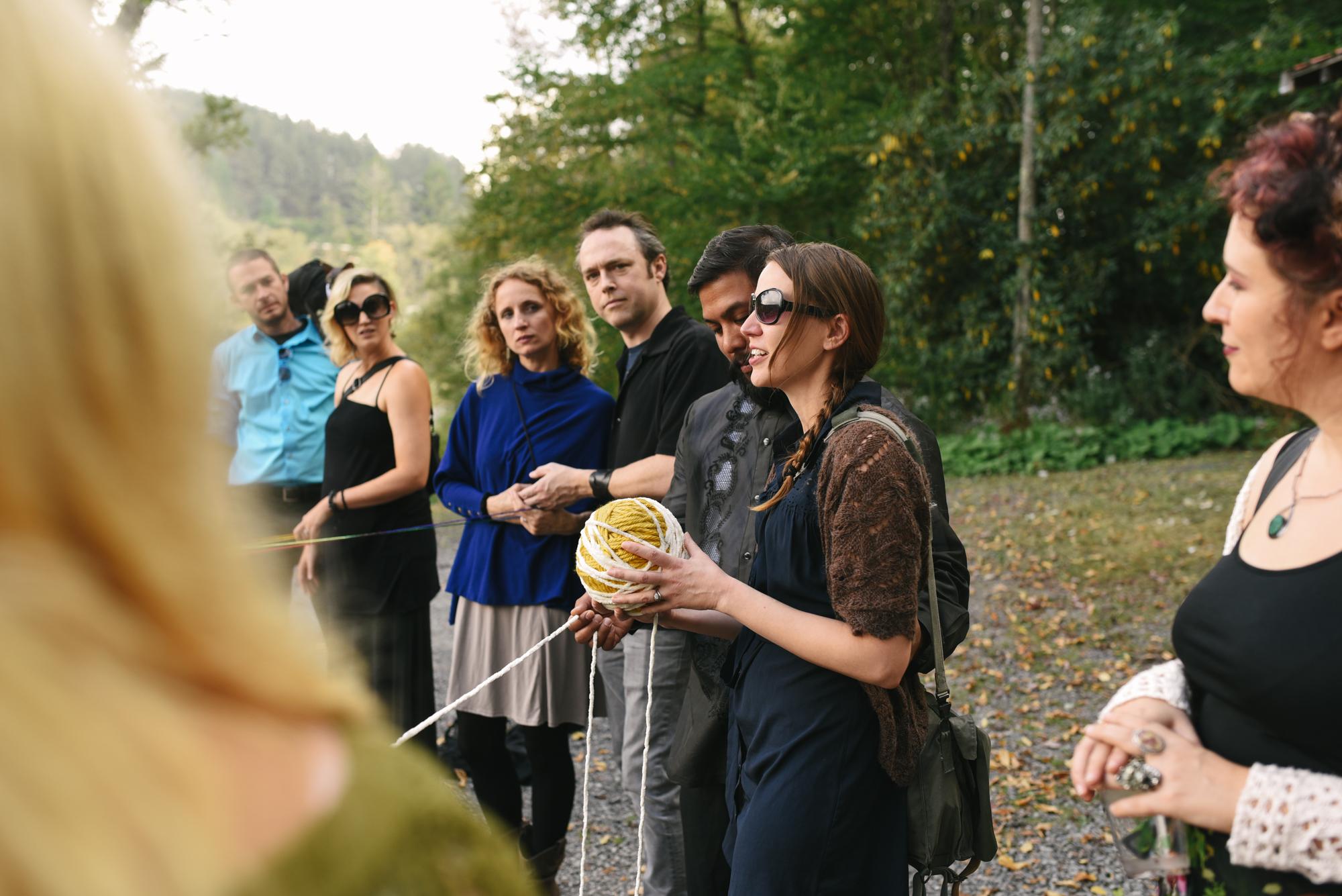 Mountain Wedding, Outdoors, Rustic, West Virginia, Maryland Wedding Photographer, DIY, Casual, taking part in yarn weaving ceremony