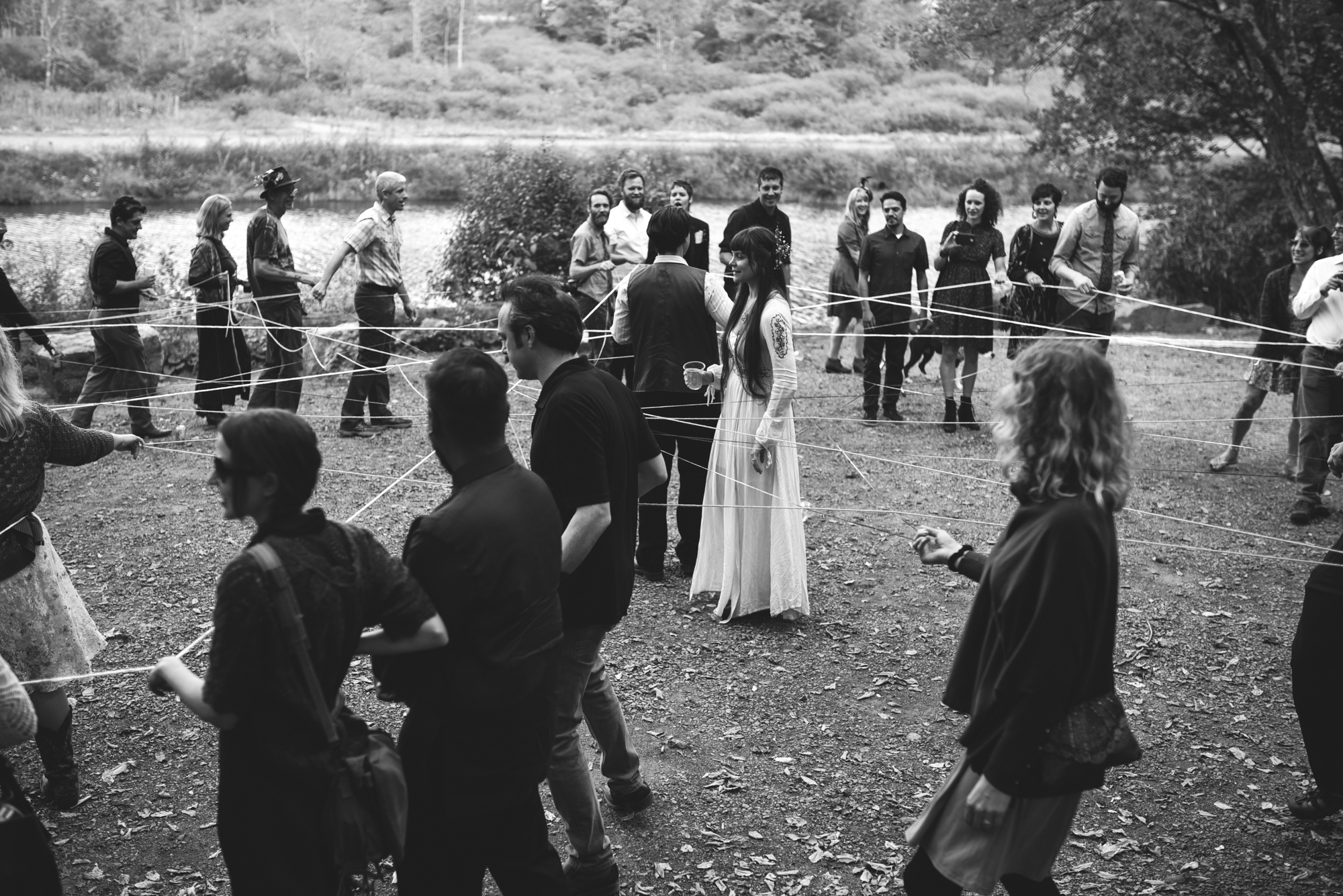Mountain Wedding, Outdoors, Rustic, West Virginia, Maryland Wedding Photographer, DIY, Casual, black and white photo, bride and groom during yarn weaving ceremony