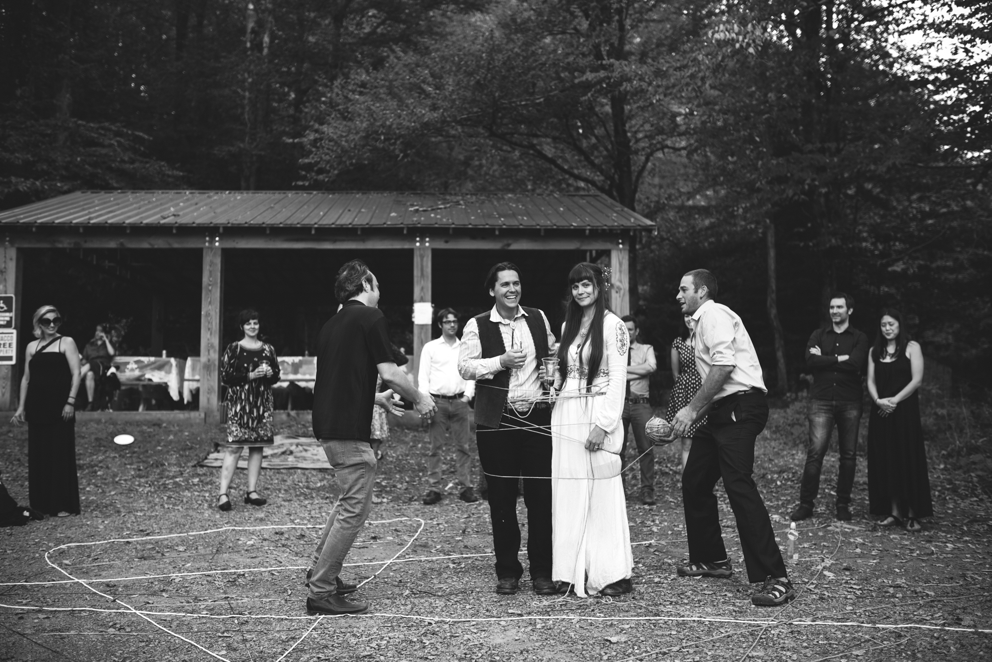 Mountain Wedding, Outdoors, Rustic, West Virginia, Maryland Wedding Photographer, DIY, Casual, bride and groom being joined with yarn, black and white photo, yarn ceremony