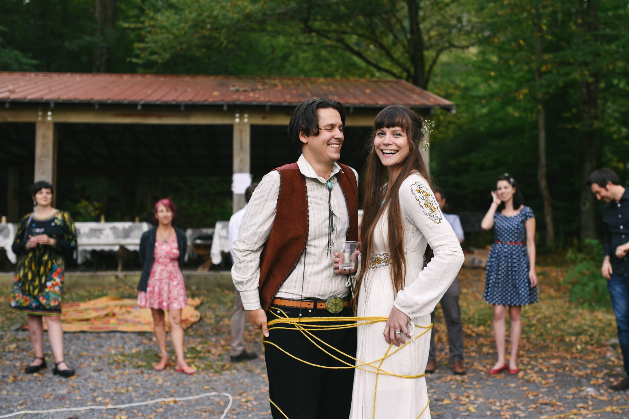 Mountain Wedding, Outdoors, Rustic, West Virginia, Maryland Wedding Photographer, DIY, Casual, bride and groom tied together with yarn, laughing and smiling together