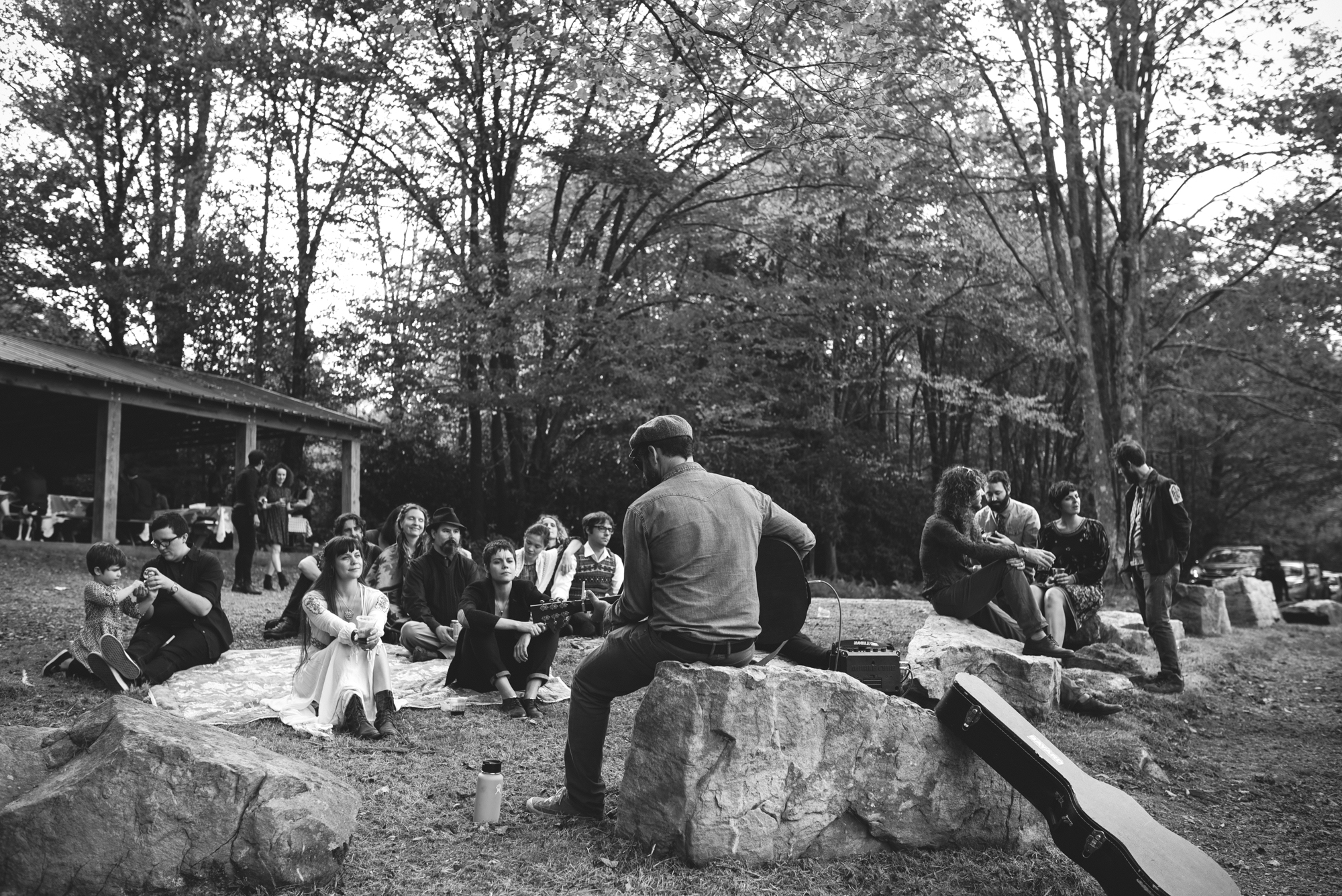 Mountain Wedding, Outdoors, Rustic, West Virginia, Maryland Wedding Photographer, DIY, Casual, friend playing guitar in front of guests, black and white photo