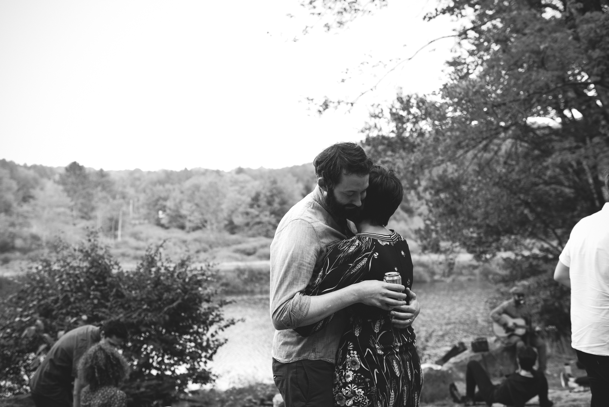 Mountain Wedding, Outdoors, Rustic, West Virginia, Maryland Wedding Photographer, DIY, Casual, couple hugging next to river, Blackwater river, black and white photo
