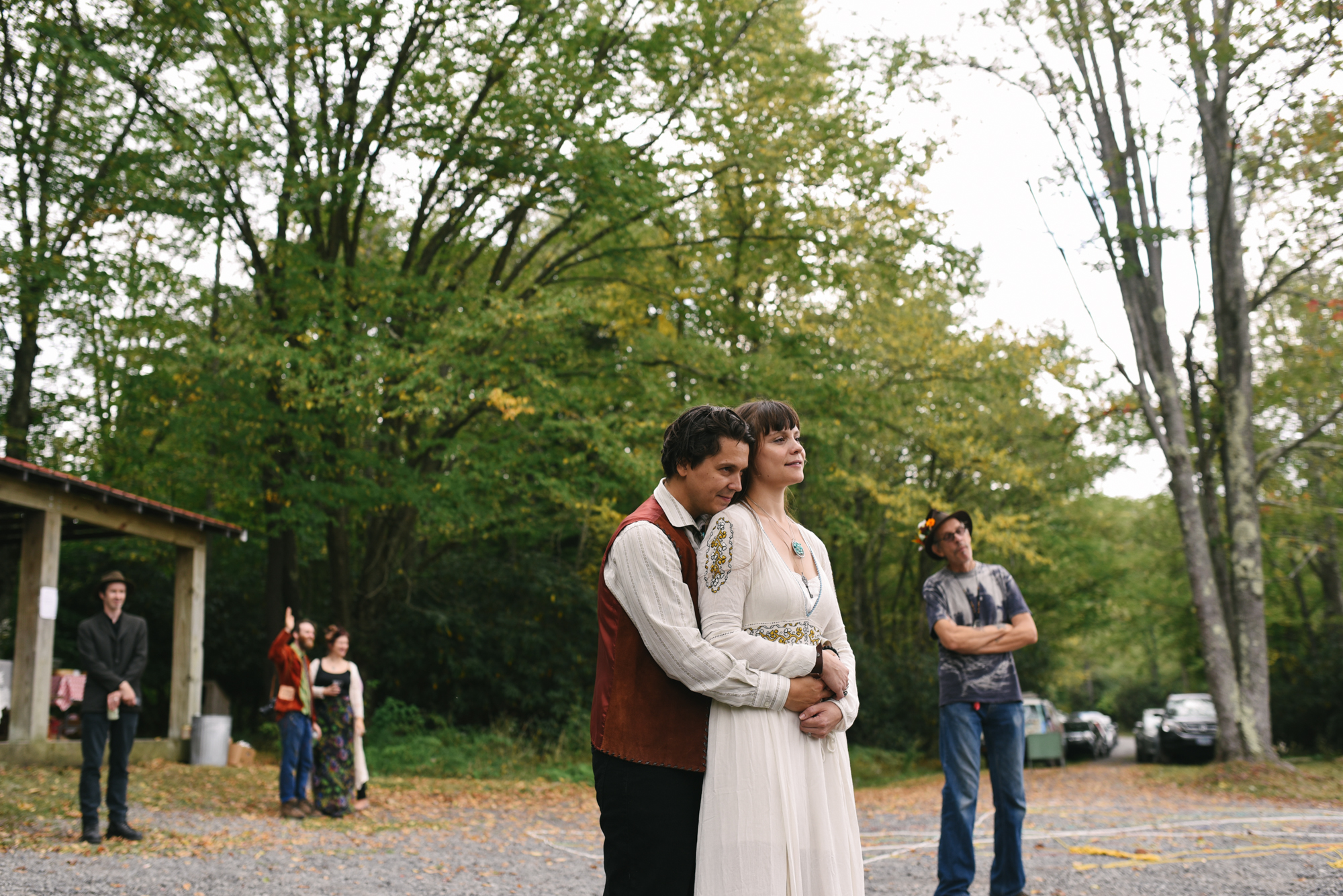 Mountain Wedding, Outdoors, Rustic, West Virginia, Maryland Wedding Photographer, DIY, Casual, groom holding bride from behind while watching musician