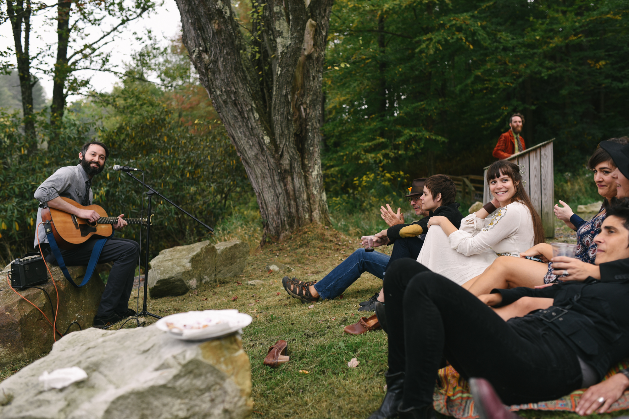 Mountain Wedding, Outdoors, Rustic, West Virginia, Maryland Wedding Photographer, DIY, Casual, guests sitting in grass outside, friend playing guitar